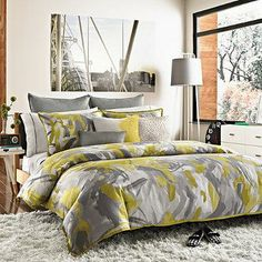 With bold brush strokes of citron and platinum tones, this chic Swirl duvet cover is the ultimate expression in style.
