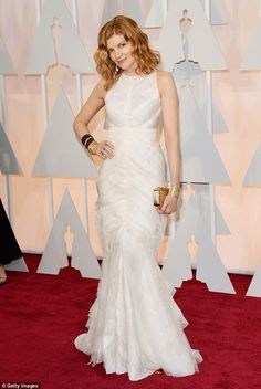 All dressed in white: Actress Rene Russo opted for an $11,000 design, also by J. Mendel