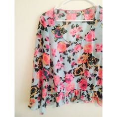 Floral Blouse Bright and colorful floral blouse! It's a little sheer so I'd wear a cami under it! Size medium Tops Blouses