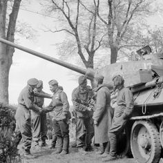 Men of 6th Airborne Division greet the crew of a Russian tank during the link-up of British and Soviet forces near Wismar.