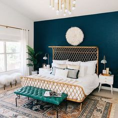 That wicker curved bed is just amazing. And I'm loving the teal green footstool with the dark blue indigo wall