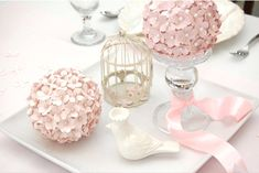 These look like punched paper flowers attached to a ball with pins. Great easy idea for DIY