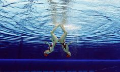Natalia Ischenko and Svetlana Romanshina of Russia compete during women's duet synchronized swimming preliminary round at the Aquatics Centre in the Olympic Park during the 2012 Summer Olympics in London, Aug. 6, 2012.
