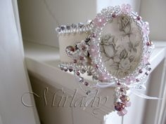Shabby Chic cuff bracelet with roses in silver grey and creamy white and a touch of purple. €89.00, via Etsy.