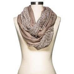 The Women's Infinity Scarf from Merona is the ultimate comfy accessory. The chic and eye-catching infinity scarf easily slips over your head for a luxuriously soft wear. The lightweight fabric is perfect for almost any type of weather, from warmer days to cooler nights. Wear it with your favorite pair of leggings, sweater and jacket for a complete look.