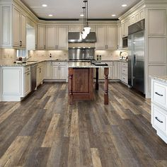 Instantly upgrade the look of your residence with the addition of this LifeProof Multi-Width Stafford Oak Luxury Vinyl Plank Flooring. Easy to maintain. Luxury Vinyl Flooring, Vinyl Plank Flooring, Luxury Vinyl Plank, Kitchen Flooring, Farmhouse Flooring, Rustic Floors, Dark Kitchen Floors, Grey Wood Floors, Wood Floor Kitchen