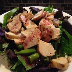 Balsamic glazed Chicken Breast on Greens & Sugar Snap Peas drizzled with Raspberry Vinaigrette.