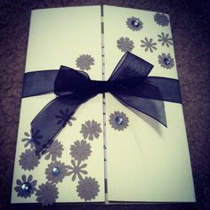 love this!  folded note card. flower punch. charcoal paper. some jewels. and ribbon. easy DIY card