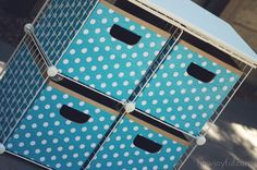 Turn old wire storage cubes into a beautiful storage unit complete with upcycled storage boxes decorated with gift wrap.  Requires a bit of work to complete, but gives a big pay off in terms of storage when you're finished!