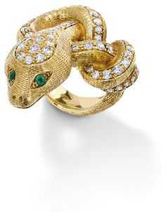 A diamond and emerald snake ring