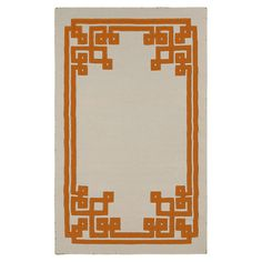 Wool flatweave rug with a geometric border motif.  Product: RugConstruction Material: 100% WoolColor...