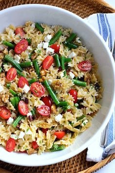 A quick and easy pasta dish with crunchy fresh green beans, sweet cherry tomatoes, olives, feta and walnuts - tossed with a lemony vinaigrette.