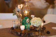 1.4.14 Heather Armstrong Photography. Ponderosa Ridge Ranch Anderson, Ca. Winter Barn Wedding. Vintage oil lamp centerpieces, burlap and wood centerpieces