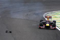 Mark Webber of Australia and Red Bull Racing rejoins the track after spinning off