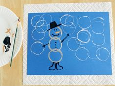 Using a paper towel/tp tube to make pics of round things - neat idea!  Great way to get the circles w/o a lot of mess.