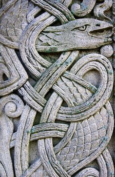 Celtic Knot Serpent. This carving is on the vertical cross beam of a Celtic High Cross grave marker in Oak Wood cemetery, Dixon, Illinois
