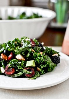 Triple berry kale salad with strawberry vinaigrette - packed with nutrients!