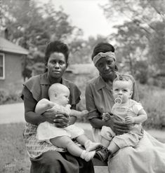 """1951, somewhere in the Southeast. Maids with their employers' babies. Photo by John Vachon for a Look magazine assignment on """"The South"""" in what could have been a prologue to """"The Help."""""""