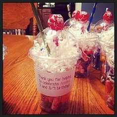 "Fill up with candy, white paper for the ""whipped cream"", punch a hole in the side of the lid for the pencil straw, and add a lollipop for the ""cherry"" then add a label saying whatever you want. So cute."
