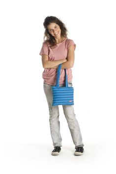 This medium-sized shoulder bag is a great bag for the woman on-the-go. Store anything from your cell phone, keys and makeup to your tablet in this lightweight, yet durable shoulder bag. Adjust the strap to suit any over-the-shoulder style and have some fun with the one long zipper that holds this bag together.