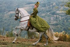 She is NOT riding sidesaddle but the dress is pretty cool!