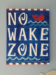 """I found a lot of variations of the """"No Wake Zone"""" sign online and decided to paint one myself. I purchased letter and animal stencils from Michaels along with red, white, light blue, and navy paint. Whale Nursery, Nursery Signs, Nursery Ideas, No Wake Zone Sign, Sailboat Decor, Navy Paint, Animal Stencil, Lake Art, Lake Signs"""