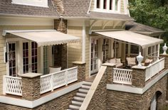 Sunbrella: Home outdoor great awnings!! perfect off the bedroom! love the stone, the colors, the french doors, the furniture.