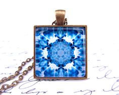 Blue mandala, italian marbleized paper necklace, 1 square glass tile in tray with chain. $11.00, via Etsy.