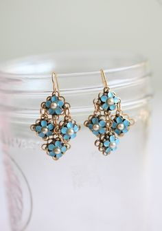 Isle Au Haut Flower Indie Earrings 29.99 at shopruche.com. These beautifully crafted gold colored earrings are the perfect touch for a sweet and feminine look. They're adorned with cute blue flowers with pearl-like centers.  1.5