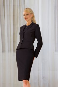 All black - black suit, black top - always works. If you're only buying one suit, try to go black. Also the smaller, simpler jewelry choice of stud earrings and a single strand of pearls is a great choice.