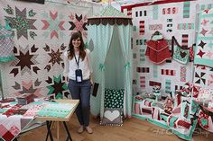 Vanessa Goertzen (Lella Boutique) in her adorable booth, showing off her debut collection for Moda Fabric, Into the Woods (love the Red Riding Hood theme!)