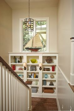 thinking outside of the box & creating book storage within staircase landing :) ... White Lake