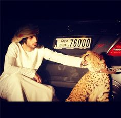 I'm not sure I understand what is going on here, but for some reason I like it. #Arab guy in #Dubai with a #cheetah.