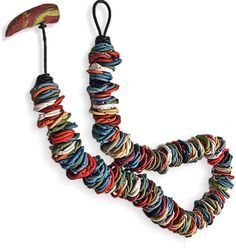 Loose, colorful, happily twirled polymer beads popped into view this week. Kathryn Corbin's necklace starts with big textured peach-colored tubes on a thick cord. In the center, bigger loops of random surface textures in springy colors overlap [...]