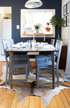 The dining chairs were purchased from IKEA and painted grey.