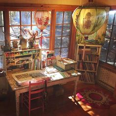 Katie Daisys painting studio. Love the lighting and the mix of supplies with some other fun and unusual elements, like the paper lanterns. So pretty!
