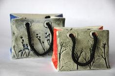 With slabs of clay we created these elegant handbags copying them from paper bags that you find in the shops. The surface was imprinted with flowers to create a texture inspired by nature. After ...