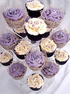 cream cup cakes in purple and ivory finished with silver and white sugar