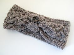 Free pattern at   http://ololi-makes.blogspot.com/2012/01/cable-knit-headband.html Note: use the written directions in the comments at bottom of the page.  Apparently the diagram is wrong.
