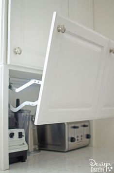 You will love all the Creative Hidden Kitchen Storage Solutions in this remodel! | Design Dazzle #kitchenimprovementideas