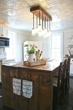 A hand-stamped tin ceiling defines the dual islands in this ... on painting bedroom ceilings, diy bedroom ceilings, decorating bedroom shelves, master bedroom ceilings, decorating bedroom walls, decorating bedroom furniture,