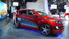 NEW YORK — The 2013 New York International Auto Show brought the shiniest new car models to the Big Apple this week, but none are as much fun as the Justice League-inspired vehicles from Kia Motors.