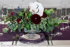 purple tablescape - photo by Jessica Hill Photography http://ruffledblog.com/plum-toned-stained-glass-wedding