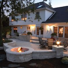 Patio with fire pit. I like how half the fire pit is surrounded by the patio. Might have to do without the wall Outdoor Rooms, Outdoor Decor, Outdoor Patios, Patio Decks, Outdoor Living Spaces, Outdoor Lighting, Paver Deck, Paver Fire Pit, Paver Sand