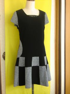 Elegant and stylish patchwork tunic/dress. I like the graduation of squares and rectangles in the peplum, and the round pockets.
