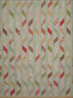 Ribbon Quilt. Half square triangles with sashing in between rows. I might be able to do this one.