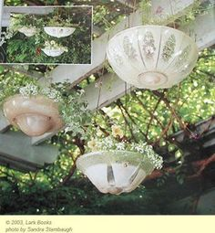 Vintage ceiling lights turned into planters?  Wow.  Creative minds.