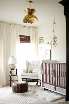 Beautiful calming nursery with gold flower light fixture