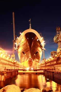 This image of a #cruise ship in dry dock is unique. I was there at a rare moment to capture the beautiful evening scene influenced by dock lighting, creating this spectacle. #HAL (Photo by:  Marco van Belleghem)