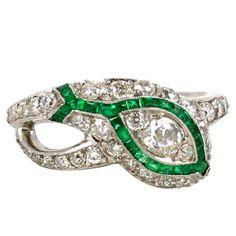An Art Deco Diamond and Emerald Serpent Ring, circa1920